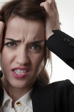 sexy frustrated woman office worker pulling out her hair not very happy Stock Photo