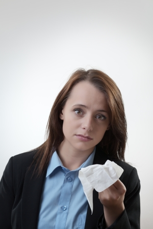 Businesswoman blowing her nose flu going around at work Stock Photo - 22685480