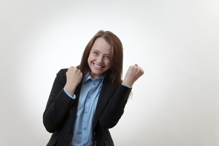 Triumphant and Happy business woman celebrating success  photo
