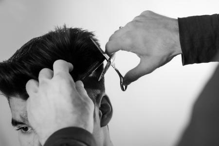 haircut: close up shot of man getting his hair cut
