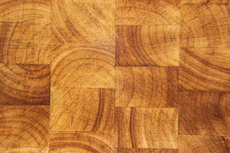 looking straight down at a well used wooden chopping board photo