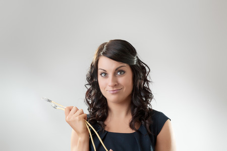woman holding network leads looking  photo