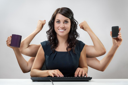 busy  business woman multitasking in the office with six arms photo