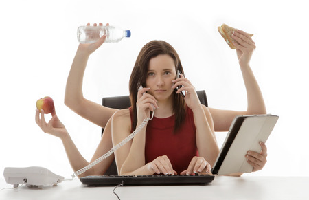 hectic: busy business woman multitasking in the office with eight arms Stock Photo