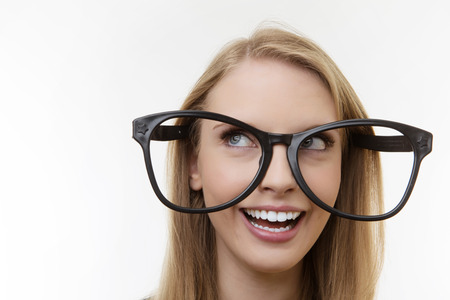 funny glasses: professional looking woman wearing large funny glasses