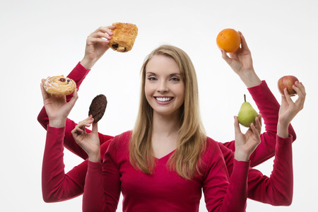 woman with six arms holding cake and fruit not sure what to eat  photo