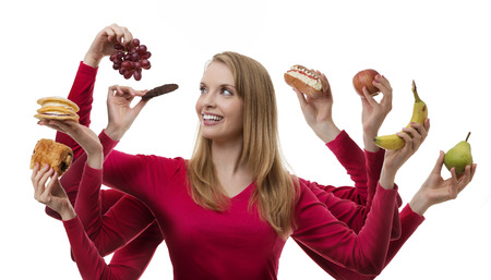 woman with eight arms holding fruit and cakes in each hand photo