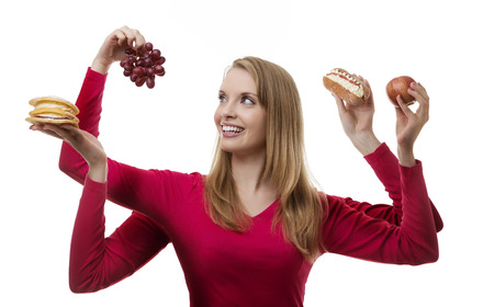 woman with four arms holding fruit and cakes in each hand photo