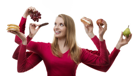 woman with six arms holding fruit and cakes in each hand photo