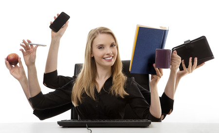 busy business woman multitasking in the office with six arms Standard-Bild