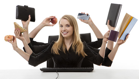 busy business woman multitasking in the office with eight arms  photo