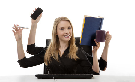 hectic: busy business woman multitasking in the office with four arms