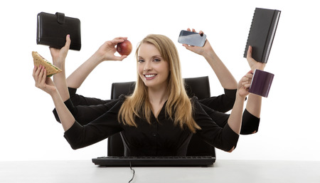 hectic: busy business woman multitasking in the office with six arms Stock Photo