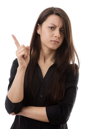 woman wagging her finger at something not looking to happy  photo