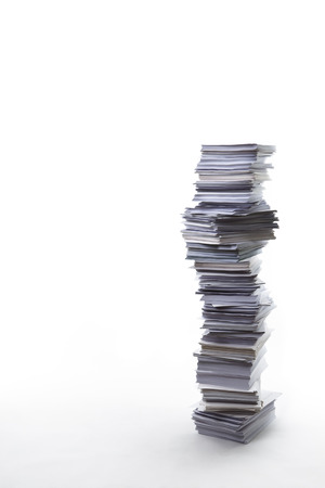 Very large stack of paper shot on white background Stock Photo