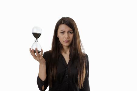 sand timer: woman holding up a hour glass sand timer watching time slip away