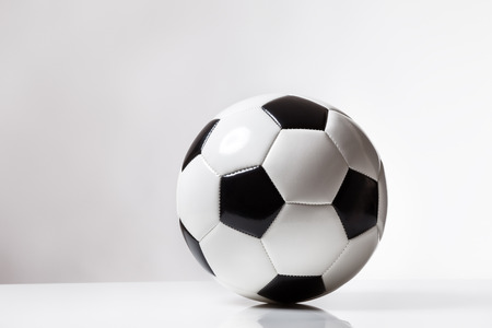 still life image of a traditional black and white football photo