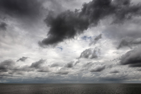 shot taken on east mersea island looking out across the sea with a moody sky Stock Photo