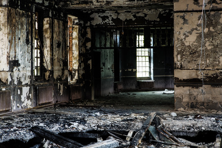 inside view of a deserted run down building after a fire