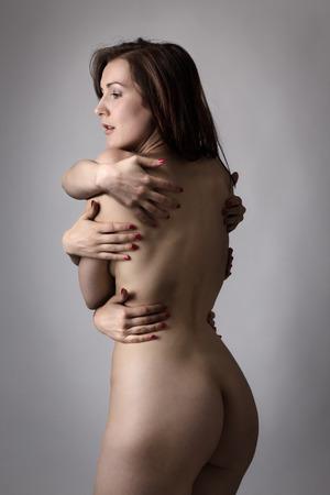naked woman back: Portrait der sch�nen nackten Frau zur�ck mit vielen H�nden auf sie Lizenzfreie Bilder