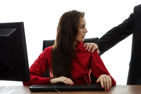 inappropriate: woman being inappropriate touched at work Stock Photo