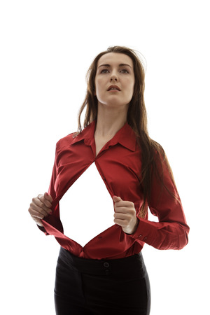super woman: attractive businesswoman pulling her shirt apart doing a hero business poses Stock Photo