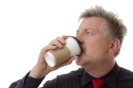 businessman drinking coffee from a paper cup photo