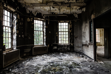 dirty room: inside view of a deserted run down building after a fire