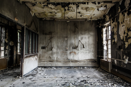 inside view of a deserted run down building after a fire photo