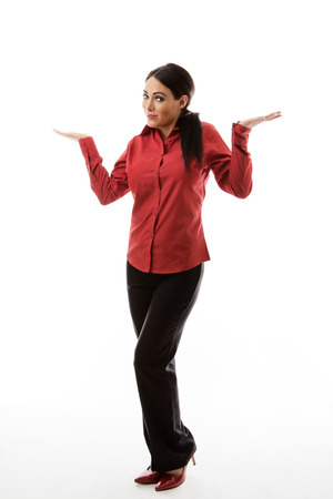 standing helpless business woman shrugging her shoulders photo