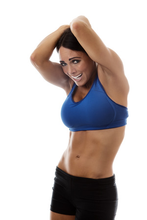 arms above head: fitness woman protecting hes self with her arms above her head as if objects where falling from the sky