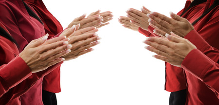 row of female hands clapping photo