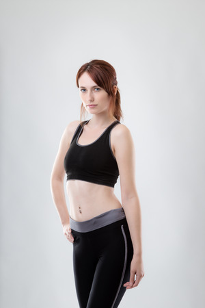 keep fit: standing woman in keep fit clothes