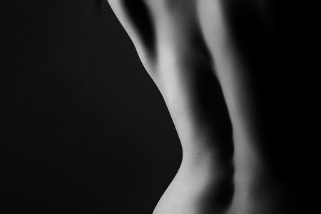 naked body: nude black and white abstract form and shape of a young women