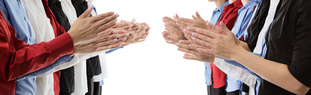 clap: row of female hands clapping Stock Photo