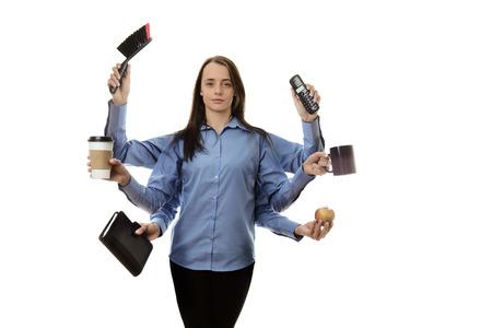drukke vrouw met vele armen multitasking-concept Stockfoto