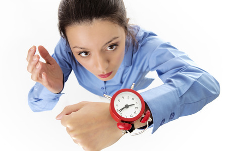 girl with a wristwatch: looking down at a business woman wearing a large wrist watch looking like she running late