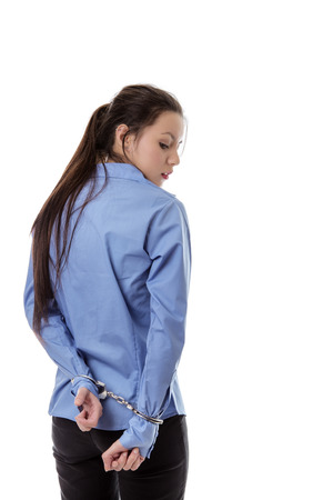 locked up: business woman locked up with her hand in handcuff Stock Photo