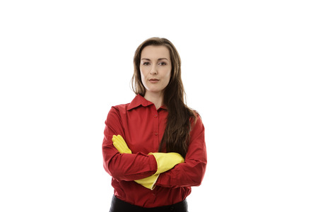 woman with arms crossed wearing rubber gloves for cleaning or washing up