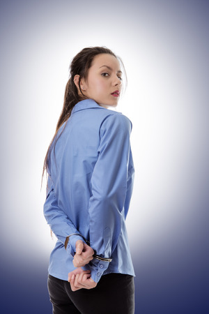 business woman locked up with her hand in handcuff Stock Photo