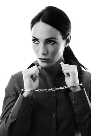 sexy woman chained up in  handcuffs Stock Photo