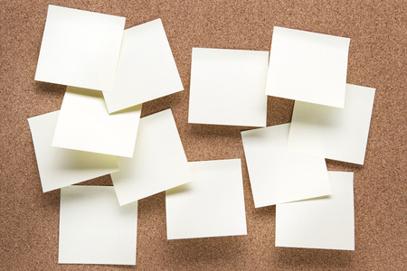 post it notes: plain cork pin board with post it notes stuck to it Stock Photo