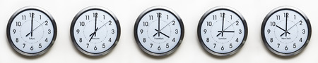 office time: clock on the wall of time zones for trading around the world set at 3PM london GMT time Stock Photo