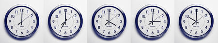 timezone: clock on the wall of time zones for trading around the world set at 3PM london GMT time. image is black and white with a blue tint Stock Photo