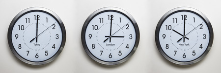 timezone: clock on the wall of time zones for trading around the world set at 3PM london GMT time Stock Photo