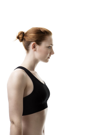 keep fit: side profile of a young woman wear keep fit clothes thinking to herself Stock Photo