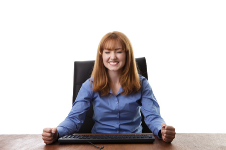 at her desk: business woman sitting at her desk Stock Photo