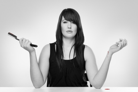cut wrist: Woman cutting her wrist wit a cut throat razor
