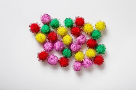 pom: small kids craft pom poms background image Stock Photo