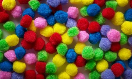 pom poms: small kids craft pom poms background image Stock Photo